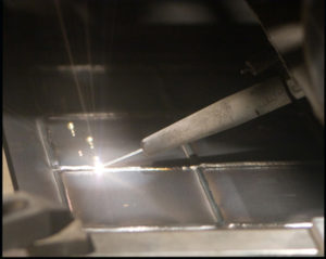 A beam laying down a molten wire for additive layer manufacturing